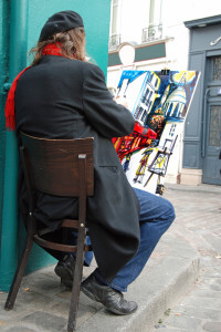 man painting outside