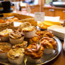 close up of buns and cakes at cafe or bakery