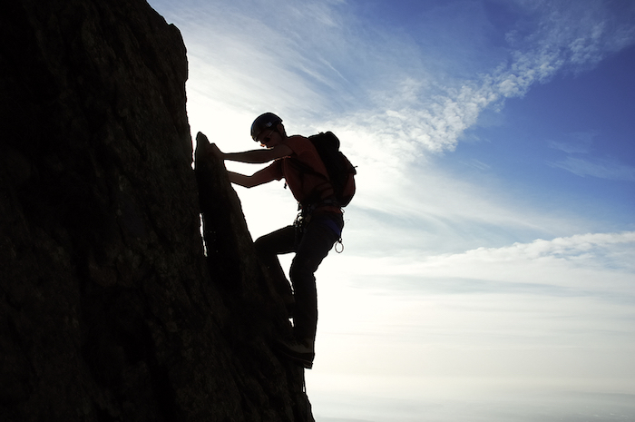 Mountain climber; business challenges concept