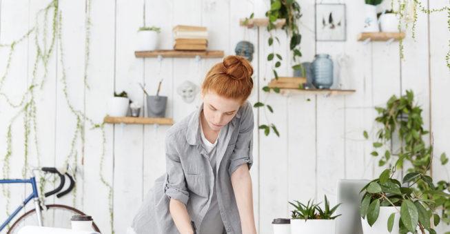 Women works on plans at desk; business planning concept