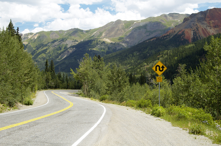 Winding scenic road in the mountains; entrepreneurship challenges concept