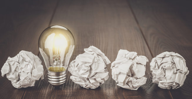 Lightbulb and crumpled paper; business planning concept