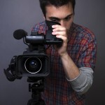 Young Man Filming With Video Camera - Square