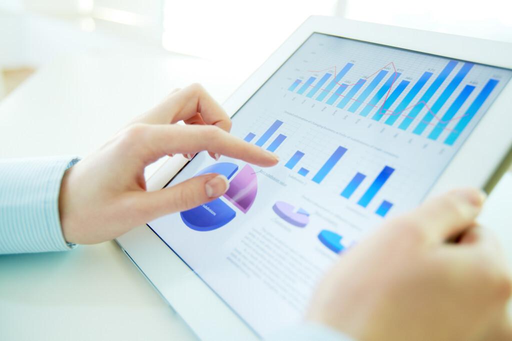 Woman Analyzing Metrics on Tablet