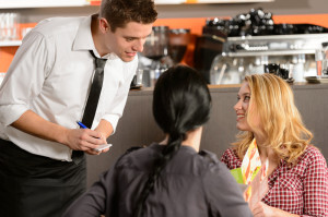 restaurant manager listening to customers