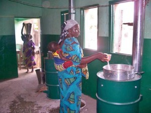 A woman works in a Nigerian stove factory (via instove.org).