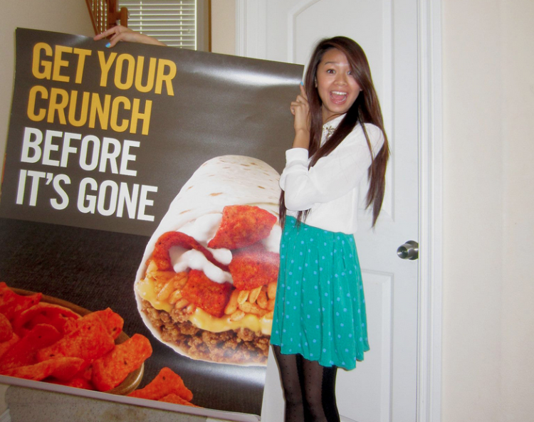 Image of Ana Lai with her poster, via skyrocketgroup.com
