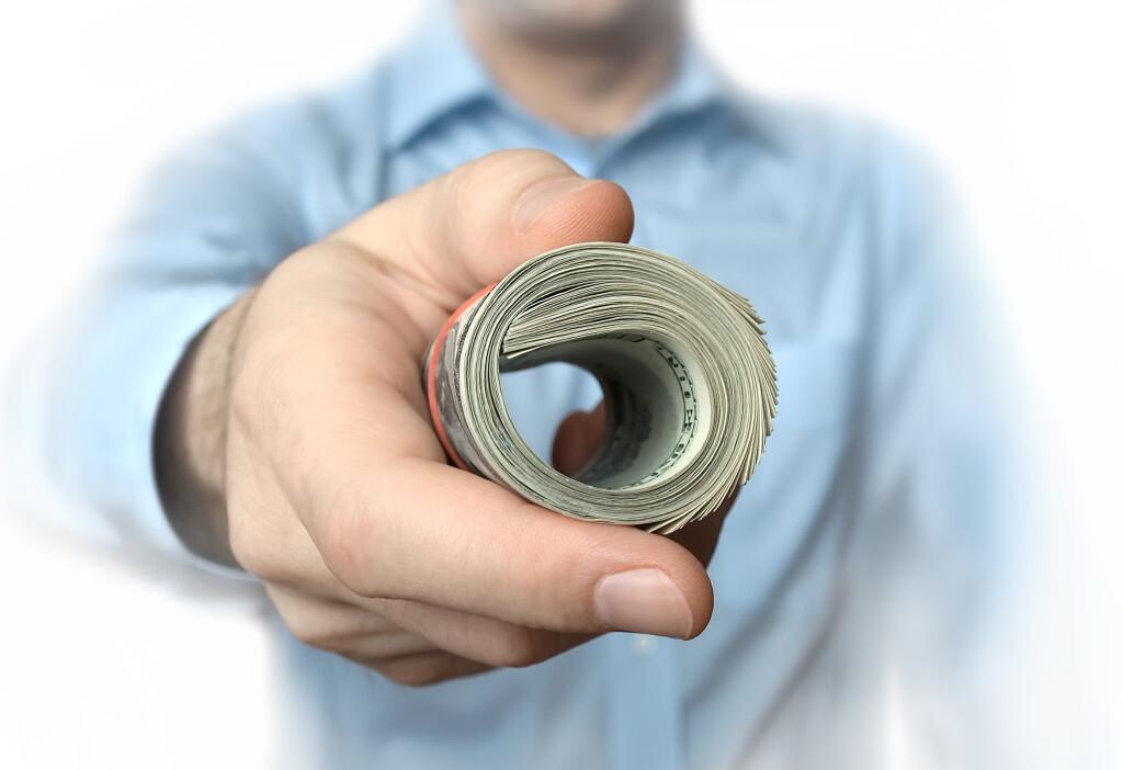 https://pas-wordpress-media.s3.amazonaws.com/content/uploads/2015/07/Man-Handing-Over-Roll-of-Dollars-1024x702.jpg
