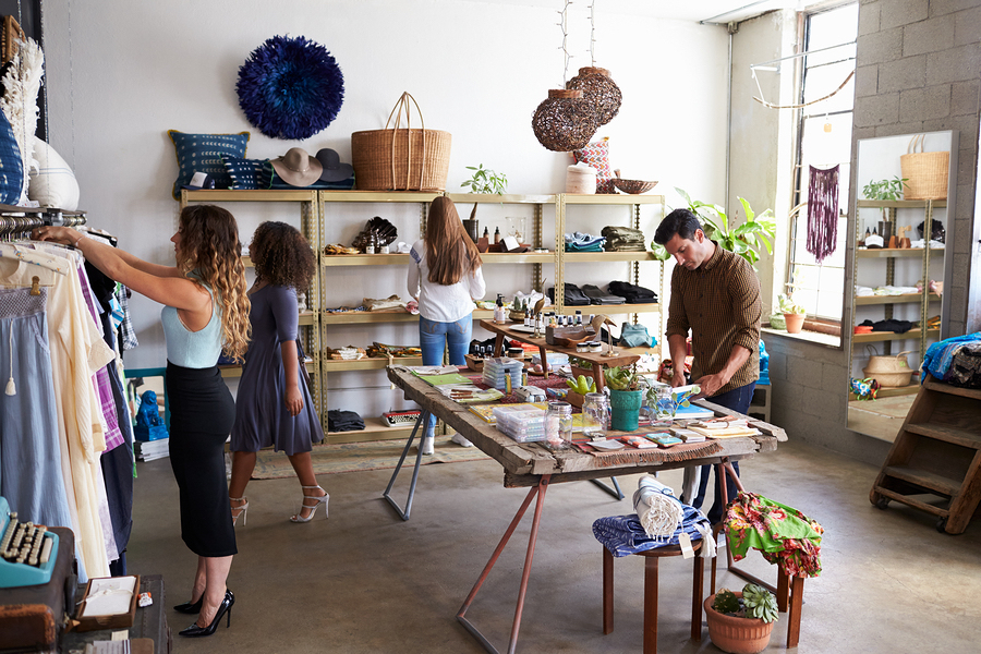 Customers and staff in a busy boutique; small business marketing concept