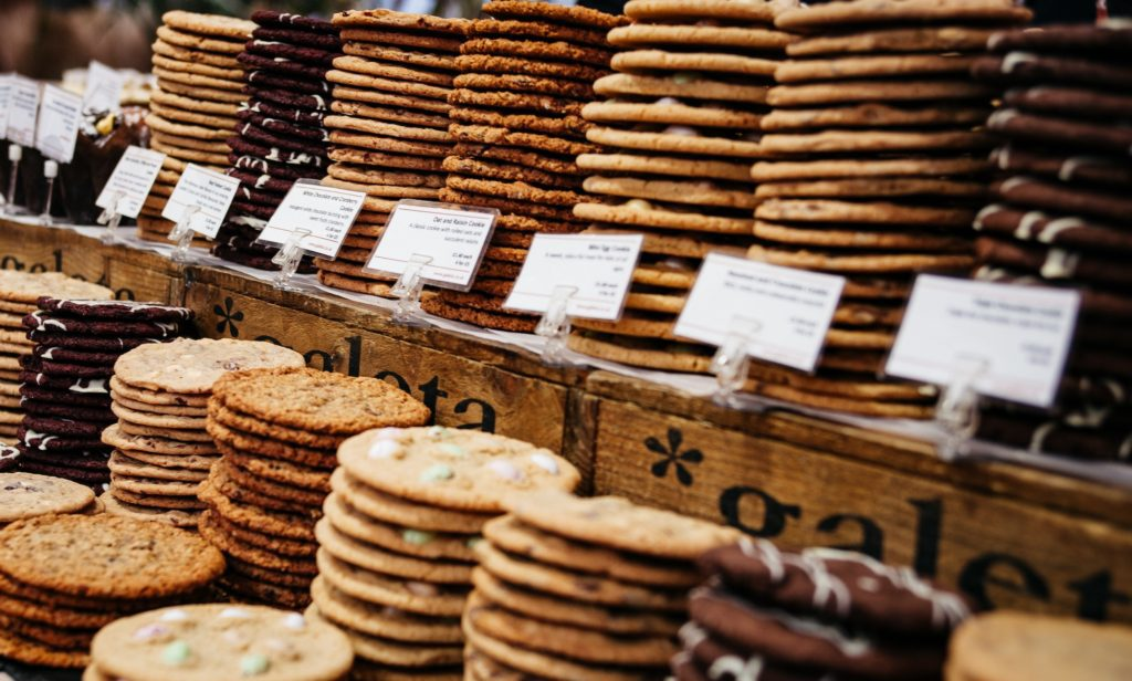 Cookies on display at a bakery; how to start a bakery