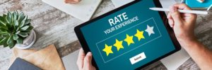 image of a customer using her iPad to rate a business out of the five star scale