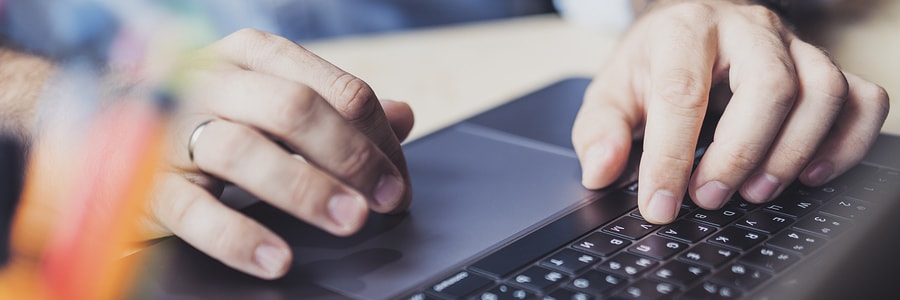close up of employee filtering through emails on computer