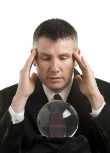 Businessman looks into crystal ball
