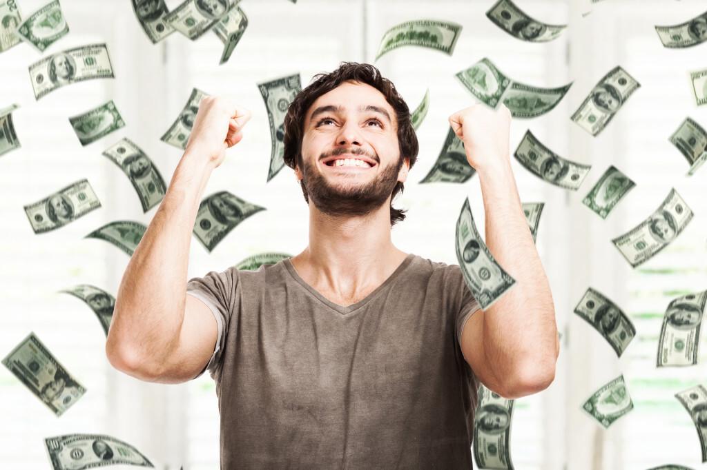Man in rain of money